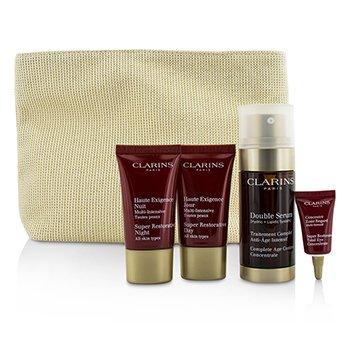 Clarins Skin-Replenishing Expert Set: Double Serum 30ml + Super Restorative Day Cream 15ml + Night Cream 15ml + Eye Concentrate 3ml + Bag  4pcs+1bag